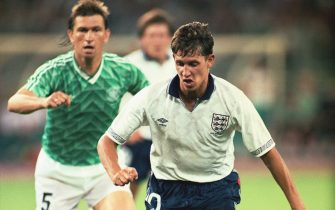 Klaus Augenthaler  of the Federal Republic of Germany looks on as Gary Lineker of England goes past him during the FIFA World Cup Finals 1990 Semi-Final match between West Germany and England played at the Stadio Delle Alpi, in Turin, Italy on July 4, 1990. The match ended in a 1-1 draw after extra-time, with West Germany winning 4-3 in the penalty shoot-out. (Photo by David Cannon/Getty Images)