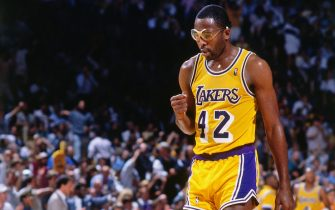 LOS ANGELES, CA - 1988: James Worthy #42 of the Los Angeles Lakers looks on during a game circa 1988 at The Forum in Los Angeles, California. NOTE TO USER: User expressly acknowledges and agrees that, by downloading and/or using this Photograph, user is consenting to the terms and conditions of the Getty Images License Agreement. Mandatory Copyright Notice: Copyright 1988 NBAE (Photo by Andrew D. Bernstein/NBAE via Getty Images)