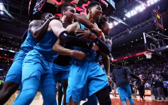 TORONTO, ON - MARCH 24:  Jeremy Lamb #3 of the Charlotte Hornets celebrates with teammates after sinking a buzzer beater to win an NBA game against the Toronto Raptors at Scotiabank Arena on March 24, 2019 in Toronto, Canada.  NOTE TO USER: User expressly acknowledges and agrees that, by downloading and or using this photograph, User is consenting to the terms and conditions of the Getty Images License Agreement.  (Photo by Vaughn Ridley/Getty Images)
