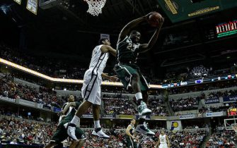 during the semifinals of the 2011 Big Ten Men's Basketball Tournament at Conseco Fieldhouse on March 12, 2011 in Indianapolis, Indiana.