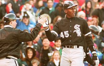 CHICAGO, IL - APRIL 7:  Chicago White Sox outfielder Michael Jordan (R) is greeted by a unidentified batboy at Chicago's Wrigley Field, 07 April 1994, after scoring on a sixth inning home run during a crosstown exhibition game against the Cubs. Jordan, who will return to the minor leagues after the game, had two hits as the teams tied 4-4.  (Photo credit should read EUGENE GARCIA/AFP via Getty Images)