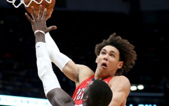 NEW ORLEANS, LOUISIANA - DECEMBER 05: Jaxson Hayes #10 of the New Orleans Pelicans dunks oer Cheick Diallo #14 of the Phoenix Suns during a game at the Smoothie King Center on December 05, 2019 in New Orleans, Louisiana. NOTE TO USER: User expressly acknowledges and agrees that, by downloading and or using this photograph, User is consenting to the terms and conditions of the Getty Images License Agreement. (Photo by Sean Gardner/Getty Images)