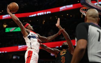 WASHINGTON, DC - FEBRUARY 21: Bradley Beal #3 of the Washington Wizards dunks on Andre Drummond #3 of the Cleveland Cavaliers during the second half at Capital One Arena on February 21, 2020 in Washington, DC. (Photo by Patrick Smith/Getty Images)
