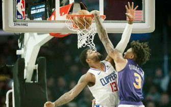 LOS ANGELES, CA - DECEMBER 17: Kelly Oubre Jr. #3 of the Phoenix Suns dunks the ball over Paul George #13 of the LA Clippers on December 17, 2019 at STAPLES Center in Los Angeles, California. NOTE TO USER: User expressly acknowledges and agrees that, by downloading and/or using this Photograph, user is consenting to the terms and conditions of the Getty Images License Agreement. Mandatory Copyright Notice: Copyright 2019 NBAE (Photo by Chris Elise/NBAE via Getty Images)