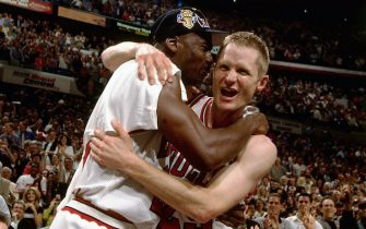 CHICAGO - 1997:  Steve Kerr #25 and Michael Jordan #23 of the Chicago Bulls celebrate after defeating the Utah Jazz to win the NBA Championship at the United Center circa 1997 in Chicago, Illinois.  NOTE TO USER: User expressly acknowledges and agrees that, by downloading and or using this  photograph, User is consenting to the terms and conditions of the Getty Images License Agreement.  Maditory Copyright notice: Copyright NBAE 1997 (Photo by Nathaniel S. Butler/NBAE via Getty Images)