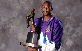 SALT LAKE CITY - MAY 1997:  Karl Malone #32 of the Utah Jazz poses for a portrait with the MVP trophy  circa May 1997 in Salt Lake City, Utah.  NOTE TO USER: User expressly acknowledges and agrees that, by downloading and/or using this Photograph, user is consenting to the terms and conditions of the Getty Images License Agreement.  Mandatory Copyright Notice: Copyright 1997 NBAE (Photo by Andy Hayt/NBAE via Getty Images)