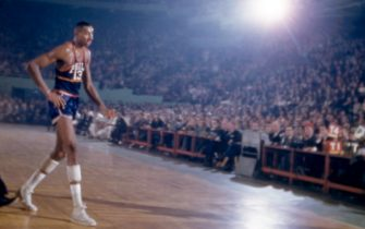 BOSTON, MA - NOVEMBER 25:  Wilt Chamberlain #13 of the Philadelphia Warriors walks off the court as Tom Heinsohn #15 of the Boston Celtics wipes his brow during an NBA game on November 25, 1959 at the Boston Garden in Boston, Massachusetts.  (Photo by Hy Peskin/Getty Images) (Set Number: X6393)