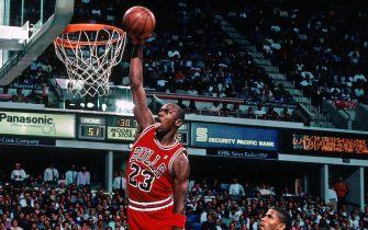 SACRAMENTO, CA - NOVEMBER 14: Michael Jordan #23 of the Chicago Bulls dunks against Rodney McCray #22 of the Sacramento Kings during a game played on November 14, 1989 at the Arco Arena in Sacramento, California. NOTE TO USER: User expressly acknowledges and agrees that, by downloading and or using this photograph, User is consenting to the terms and conditions of the Getty Images License Agreement. Mandatory Copyright Notice: Copyright 1989 NBAE (Photo by Rocky Widner/NBAE via Getty Images)