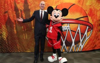 CHARLOTTE, NC - FEBRUARY 15: NBA Commissioner, Adam Silver and Mickey Mouse meet during NBA All Star Weekend in Charlotte, North Carolina on February 15, 2019 at Bojangles Coliseum. The NBA is collaborating with Walt Disney Imagineering on the new NBA Experience opening this summer at Walt Disney World Resort in Florida. This one-of-a-kind destination will bring NBA moments to life through thrilling basketball activities and interactive experiences that will appeal to boys, girls and adults. NOTE TO USER: User expressly acknowledges and agrees that, by downloading and or using this photograph, User is consenting to the terms and conditions of the Getty Images License Agreement. Mandatory Copyright Notice: Copyright 2019 NBAE (Photo by Joe Murphy/NBAE via Getty Images)