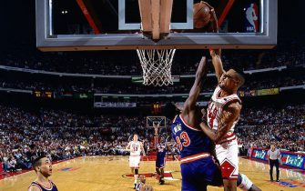 CHICAGO - 1994: Scottie Pippen #33 of the Chicago Bulls drives to the basket for a slam dunk over Patrick Ewing of the New York Knicks in 1994  during an NBA game at The United Center in Chicago, Illinois.  NOTE TO USER: User expressly acknowledges  and agrees that, by downloading and or using this  photograph, User is consenting to the terms and conditions of the Getty Images License Agreement. (Photo by Nathaniel S. Butler/ NBAE/ Getty Images)