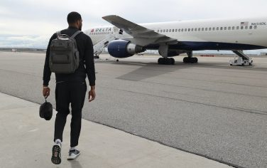 SALT LAKE CITY, UT - MARCH 05:  Derrick Favors #15 of the Utah Jazz arrives to the charter plane on the way to play the New Orleans Pelicans on March 05, 2019 in Salt Lake City, Utah. NOTE TO USER: User expressly acknowledges and agrees that, by downloading and or using this Photograph, User is consenting to the terms and conditions of the Getty Images License Agreement. Mandatory Copyright Notice: Copyright 2019 NBAE (Photo by Melissa Majchrzak/NBAE via Getty Images)