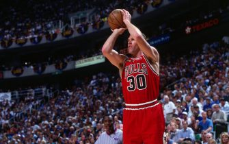 SALT LAKE CITY, UT - JUNE 14:  Jud Buechler #30 of the Chicago Bulls shoots a jump shot during Game Six of the 1998 NBA Finals against the Utah Jazz played on June 14, 1998 at the Delta Center in Salt Lake City.  Chicago defeated Utah 87-86 and won the series 4-2 and the 1998 NBA Championship.  NOTE TO USER: User expressly acknowledges that, by downloading and or using this photograph, User is consenting to the terms and conditions of the Getty Images License agreement. Mandatory Copyright Notice: Copyright 1998 NBAE (Photo by Andy Hayt/NBAE via Getty Images)