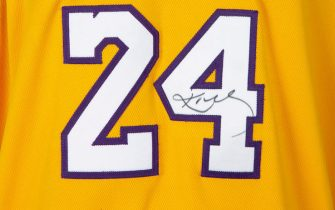 "UNSPECIFIED,  - MAY 01: (EDITORIAL USE ONLY) This handout image provided by Julien's Auctions shows an Adidas brand Kobe Bryant Los Angeles Lakers home jersey game-worn during the 2006-2007 season, Bryant has signed the number ""24"" to the front in black marker. The Sports Legends auction, hosted by Julien's Auctions, will take place on May 21, 2020, and features over 300 historic sports artifacts including Kobe Bryant game-worn items, as well as a collection of FIFA World Cup, Confederations Cup and Olympic Medals.  (Photo by Handout/Julien's Auctions via Getty Images)"
