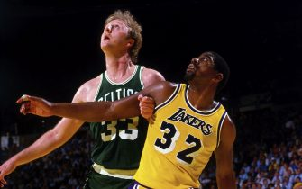 INGLEWOOD, CA - 1984: Magic Johnson #32 of the Los Angeles Lakers battles for position against Larry Bird #33 of the Boston Celtics during a game in 1984 at The Great Western Forum in Inglewood, California.  NOTE TO USER: User expressly acknowledges and agrees that, by downloading and/or using this Photograph, user is consenting to the terms and conditions of the Getty Images License Agreement. Mandatory Copyright Notice: Copyright 1984 NBAE (Photo by Andrew D. Bernstein/NBAE via Getty Images)