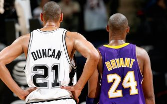 SAN ANTONIO - JANUARY 12:  Tim Duncan #21 of the San Antonio Spurs and Kobe Bryant #24 of the Los Angeles Lakers stand together during the game on January 12, 2010 at the AT&T Center in San Antonio, Texas.  The Spurs won 105-85.  NOTE TO USER: User expressly acknowledges and agrees that, by downloading and/or using this Photograph, user is consenting to the terms and conditions of the Getty Images License Agreement. Mandatory Copyright Notice: Copyright 2010 NBAE  (Photo by Chris Covatta/NBAE via Getty Images)