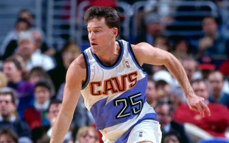 CLEVELAND - NOVEMBER 30: Mark Price #25 of the Cleveland Cavaliers dribbles  during a game played on November 30, 1994 at Gund Arena in Cleveland, Ohio. NOTE TO USER: User expressly acknowledges and agrees that, by downloading and/or using this photograph, user is consenting to the terms and conditions of the Getty Images License Agreement.  Mandatory Copyright Notice: Copyright 1994 NBAE (Photo by Noren Trotman/NBAE via Getty Images)