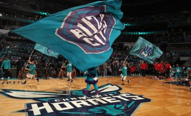 CHARLOTTE, NC - OCTOBER 20: The Charlotte Hornets mascot waves the team flag before the game against the Atlanta Hawks on October 20, 2017 at Spectrum Center in Charlotte, North Carolina. NOTE TO USER: User expressly acknowledges and agrees that, by downloading and or using this photograph, User is consenting to the terms and conditions of the Getty Images License Agreement.  Mandatory Copyright Notice:  Copyright 2017 NBAE (Photo by Kent Smith/NBAE via Getty Images)