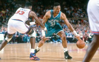 NEW YORK - CIRCA 1993:  Alonzo Mourning #33 of the Charlotte Hornets dribbles the ball while closely guarded by Patrick Ewing #33 of the New York Knicks during an NBA basketball game circa 1993 at Madison Square Garden in the Manhattan borough of New York City. Mourning played for the Hornets from 1992-95. (Photo by Focus on Sport/Getty Images) *** Local Caption *** Alonzo Mourning; Patrick Ewing
