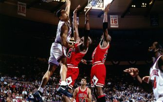 NEW YORK - 1993: John Starks #3 of the New York Knicks drives to the basket hard for a slam dunk over Horace Grant #54 and Michael Jordan #23 of the Chicago Bulls as Bill Cartwright #24 looks on during Game 2 of the Eastern Conference Finals at Madison Square Garden in New York, NY on May 23, 1993. NOTE TO USER: User expressly acknowledges and agrees that, by downloading and or using this photograph, User is consenting to the terms and conditions of the Getty Images License Agreement. (Photo by Nathaniel S. Butler/ NBAE/ Getty Images)