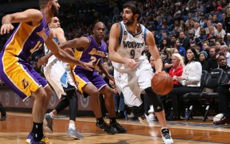 MINNEAPOLIS, MN - MARCH 28:  Ricky Rubio #9 of the Minnesota Timberwolves handles the ball against the Los Angeles Lakers on March 28, 2014 at Target Center in Minneapolis, Minnesota. NOTE TO USER: User expressly acknowledges and agrees that, by downloading and or using this Photograph, user is consenting to the terms and conditions of the Getty Images License Agreement. Mandatory Copyright Notice: Copyright 2014 NBAE (Photo by David Sherman/NBAE via Getty Images)