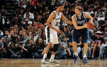 SAN ANTONIO, TX - APRIL 30: Dirk Nowitzki #41 of the Dallas Mavericks looks to control the ball against Tim Duncan #21 of the San Antonio Spurs in Game Five of the Western Conference Quarterfinals during the 2014 NBA Playoffs on April 30, 2014 at the AT&T Center in San Antonio, Texas. NOTE TO USER: User expressly acknowledges and agrees that, by downloading and/or using this Photograph, user is consenting to the terms and conditions of the Getty Images License Agreement. Mandatory Copyright Notice: Copyright 2014 NBAE (Photo by Garrett W. Ellwood/NBAE via Getty Images)