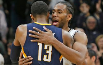 SAN ANTONIO,TX - MARCH 1:  Kawhi Leonard #2 of the San Antonio Spurs hugs Paul George #13 of the Indiana Pacers at the end of the game at AT&T Center on March 1, 2017 in San Antonio, Texas.  NOTE TO USER: User expressly acknowledges and agrees that , by downloading and or using this photograph, User is consenting to the terms and conditions of the Getty Images License Agreement. (Photo by Ronald Cortes/Getty Images)