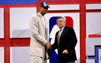 CHARLOTTE, NC - JUNE 25:  Tim Duncan taken number one overall by the San Antonio Spurs shakes NBA Commissioner David Stern's hand during the 1997 NBA Draft on June 25, 1997 at the Charlotte Coliseum in Charlotte, North Carolina. NOTE TO USER: User expressly acknowledges and agrees that, by downloading and or using this Photograph, user is consenting to the terms and conditions of the Getty Images License Agreement. Mandatory Copyright Notice: Copyright 1997 NBAE (Photo by Nathaniel S. Butler/NBAE via Getty Images)
