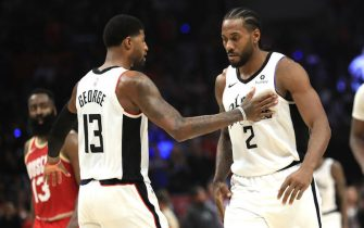 LOS ANGELES, CALIFORNIA - NOVEMBER 22:  Kawhi Leonard #2 is congratulated by Paul George #13 of the Los Angeles Clippers during the second half of a game against the Houston Rockets at Staples Center on November 22, 2019 in Los Angeles, California.  NOTE TO USER: User expressly acknowledges and agrees that, by downloading and/or using this photograph, user is consenting to the terms and conditions of the Getty Images License Agreement (Photo by Sean M. Haffey/Getty Images)
