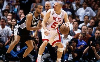 EAST RUTHERFORD, NJ - JUNE 13:  Jason Kidd #5 of the New Jersey Nets posts up against Tony Parker #9 of the San Antonio Spurs during Game five of the NBA Finals at Continental Airlines Arena on June 13, 2003 in East Rutherford, New Jersey.  The Spurs won 93-83.  NOTE TO USER: User expressly acknowledges and agrees that, by downloading and/or using this Photograph, User is consenting to the terms and conditions of the Getty Images License Agreement  Copyright 2003 NBAE  (Photo by Nathaniel S. Butler/NBAEvia Getty Images)