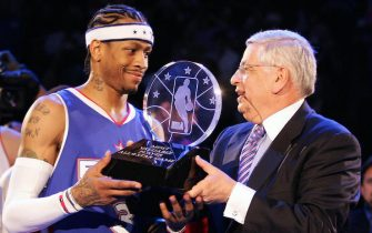 DENVER, UNITED STATES:  NBA Commissioner David Stern (R) hands Allen Iverson of the Eastern Conference team the All-Star Most Valuable Player (MVP) trophy after the NBA All-Star game 20 February 2005 in Denver. The East defeated the West 125-115.     AFP PHOTO/Don EMMERT  (Photo credit should read DON EMMERT/AFP via Getty Images)