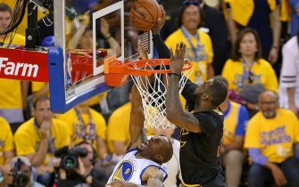 OAKLAND, CA - JUNE 19:  LeBron James #23 of the Cleveland Cavaliers blocks a shot against Andre Iguodala #9 of the Golden State Warriors during Game Seven of the 2016 NBA Finals on June 19, 2016 at ORALCE Arena in Oakland, California. NOTE TO USER: User expressly acknowledges and agrees that, by downloading and or using this Photograph, user is consenting to the terms and conditions of the Getty Images License Agreement. Mandatory Copyright Notice: Copyright 2016 NBAE (Photo by Joe Murphy /NBAE via Getty Images)