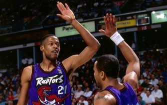 SACRAMENTO, CA - MARCH 3: Marcus Camby #21 and Damon Stoudamire #20 of the Toronto Raptors high five each other during a game played on March 3, 1997 at Arco Arena in Sacramento, California. NOTE TO USER: User expressly acknowledges and agrees that, by downloading and or using this photograph, User is consenting to the terms and conditions of the Getty Images License Agreement. Mandatory Copyright Notice: Copyright 1997 NBAE (Photo by Rocky Widner/NBAE via Getty Images)