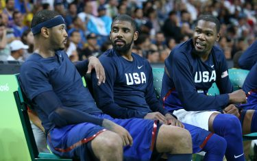 RIO DE JANEIRO, BRAZIL - AUGUST 6: Carmelo Anthony, Kyrie Irving and Kevin Durant of USA during the group phase basketball match between USA and China on day 1 of the Rio 2016 Olympic Games at Carioca Arena 1 on August 6, 2016 in Rio de Janeiro, Brazil. (Photo by Jean Catuffe/Getty Images)