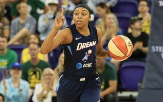 SEATTLE, WA - SEPTEMBER 1: Renee Montgomery #21 of the Atlanta Dream handles the ball against the Seattle Storm on September 1, 2019 at the Alaska Airlines Arena Arena, in Seattle, Washington. NOTE TO USER: User expressly acknowledges and agrees that, by downloading and or using this photograph, User is consenting to the terms and conditions of the Getty Images License Agreement. Mandatory Copyright Notice: Copyright 2019 NBAE  (Photo by Joshua Huston/NBAE via Getty Images)