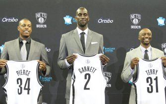 BROOKLYN, NY - July 18: Kevin Garnett #2, Paul Pierce #34, and Jason Terry #31 of the Brooklyn Nets pose with their new jerseys during a press conference at the Barclays Center on July 18, 2013 in the Brooklyn borough of New York City.  NOTE TO USER: User expressly acknowledges and agrees that, by downloading and/or using this Photograph, user is consenting to the terms and conditions of the Getty Images License Agreement. Mandatory Copyright Notice: Copyright 2013 NBAE (Photo by Nathaniel S. Butler/NBAE via Getty Images)