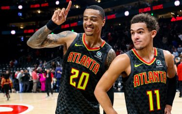 ATLANTA, GA - JANUARY 14: John Collins #20 stands with Trae Young #11 of the Atlanta Hawks following a game against the Phoenix Suns at State Farm Arena on January 14, 2020 in Atlanta, Georgia. NOTE TO USER: User expressly acknowledges and agrees that, by downloading and or using this photograph, User is consenting to the terms and conditions of the Getty Images License Agreement. (Photo by Carmen Mandato/Getty Images)