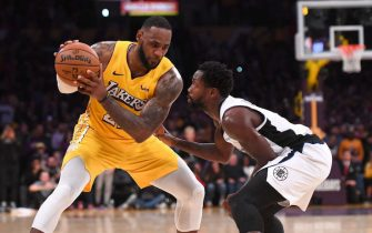 LOS ANGELES, CA - DECEMBER 25: Patrick Beverley #21 of the Los Angeles Clippers guards LeBron James #23 of the Los Angeles Lakers in the second half of the game at Staples Center on December 25, 2019 in Los Angeles, California. NOTE TO USER: User expressly acknowledges and agrees that, by downloading and/or using this Photograph, user is consenting to the terms and conditions of the Getty Images License Agreement. (Photo by Jayne Kamin-Oncea/Getty Images)