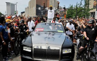 CLEVELAND, OH - JUNE 22:  LeBron James #23 of the Cleveland Cavaliers waves to the fans during the Cleveland Cavaliers Victory Parade And Rally on June 22, 2016 in downtown Cleveland, Ohio.  NOTE TO USER: User expressly acknowledges and agrees that, by downloading and/or using this Photograph, user is consenting to the terms and conditions of the Getty Images License Agreement. Mandatory Copyright Notice: Copyright 2016 NBAE  (Photo by David Liam Kyle/NBAE/Getty Images)