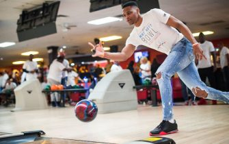 EDMOND, OK - MARCH 24:  Russell Westbrook #0 of the Oklahoma City Thunder bowls during his 7th annual Why Not? Foundation bowling event on March 24, 2017 at the AMF Boulevard Lanes in Edmond, Oklahoma. NOTE TO USER: User expressly acknowledges and agrees that, by downloading and or using this Photograph, user is consenting to the terms and conditions of the Getty Images License Agreement. Mandatory Copyright Notice: Copyright 2017 NBAE (Photo by Layne Murdoch/NBAE via Getty Images)