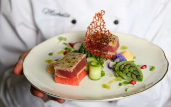 SYDNEY, AUSTRALIA - MAY 29: Chef Michelle Walsh holds the seared tuna she prepared for main course at  the Medusa Hotel during a luncheon she was hosting on May 29, 2020 in Sydney, Australia.  (Photo by Don Arnold/WireImage,)