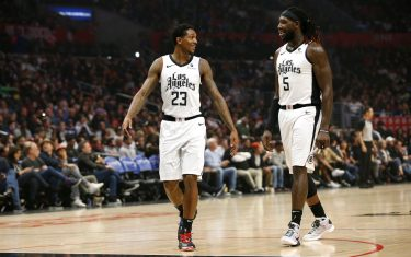 LOS ANGELES, CALIFORNIA - DECEMBER 01:  Lou Williams #23 and Montrezl Harrell #5 of the Los Angeles Clippers talk during a game against the Washington Wizards at Staples Center on December 01, 2019 in Los Angeles, California. NOTE TO USER: User expressly acknowledges and agrees that, by downloading and or using this photograph, User is consenting to the terms and conditions of the Getty Images License Agreement. (Photo by Katharine Lotze/Getty Images)