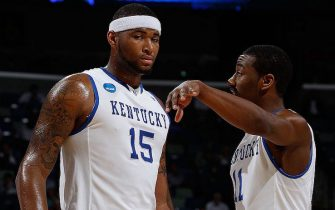 NEW ORLEANS - MARCH 18:  DeMarcus Cousins #15 and John Wall #11 of the Kentucky Wildcats talk during the game against the East Tennessee State Buccaneers during the first round of the 2010 NCAA men's basketball tournament at the New Orleans Arena on March 18, 2010 in New Orleans, Louisiana.  (Photo by Chris Graythen/Getty Images)
