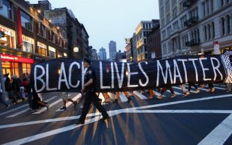 TOPSHOT - A police officer patrols during a protest in support of the Black lives matter movement in New York on July 09, 2016. - The gunman behind a sniper-style attack in Dallas was an Army veteran and loner driven to exact revenge on white officers after the recent deaths of two black men at the hands of police, authorities have said. Micah Johnson, 25, had no criminal history, Dallas police said in a statement. (Photo by KENA BETANCUR / AFP) (Photo by KENA BETANCUR/AFP via Getty Images)