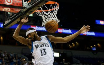 MINNEAPOLIS, MN - NOVEMBER 21: Corey Brewer #13 of the Minnesota Timberwolves dunks the ball against the San Antonio Spurs during the game on November 21, 2014 at Target Center in Minneapolis, Minnesota. The Spurs defeated the Timberwolves 121-92. NOTE TO USER: User expressly acknowledges and agrees that, by downloading and or using this Photograph, user is consenting to the terms and conditions of the Getty Images License Agreement. (Photo by Hannah Foslien/Getty Images)