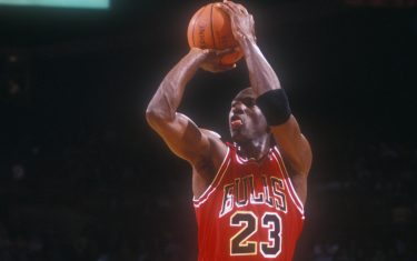 LANDOVER, MD - DECEMBER 14: Michael Jordan #23 of the Chicago Bulls takes a jump shot during a basketball game against the Washington Bullets at the Capitol Centre on December 14, 1991 in Landover , Maryland. The Bulls won 113 -100. (Photo by Mitchell Layton/Getty Images)