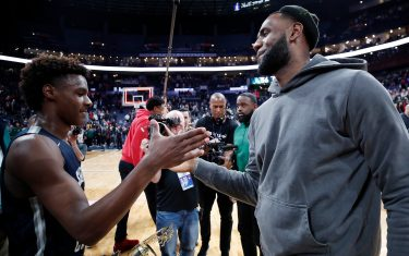COLUMBUS, OH - DECEMBER 14: LeBron 'Bronny' James Jr. #0 of Sierra Canyon High School is greeted by his father LeBron James of the Los Angeles Lakers following the Ohio Scholastic Play-By-Play Classic against St. Vincent-St. Mary High School at Nationwide Arena on December 14, 2019 in Columbus, Ohio. (Photo by Joe Robbins/Getty Images)