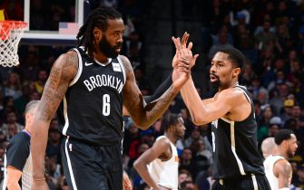 DENVER, CO - NOVEMBER 14: DeAndre Jordan #6 and Spencer Dinwiddie #8 of the Brooklyn Nets high five each other during the game against the Denver Nuggets on November 14, 2019 at the Pepsi Center in Denver, Colorado. NOTE TO USER: User expressly acknowledges and agrees that, by downloading and/or using this Photograph, user is consenting to the terms and conditions of the Getty Images License Agreement. Mandatory Copyright Notice: Copyright 2019 NBAE (Photo by Bart Young/NBAE via Getty Images)
