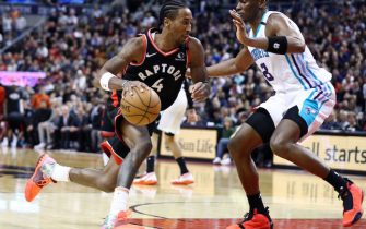 TORONTO, ON - FEBRUARY 28:  Rondae Hollis-Jefferson #4 of the Toronto Raptors dribbles the ball as Bismack Biyombo #8 of the Charlotte Hornets defends during the second half of an NBA game at Scotiabank Arena on February 28, 2020 in Toronto, Canada.  NOTE TO USER: User expressly acknowledges and agrees that, by downloading and or using this photograph, User is consenting to the terms and conditions of the Getty Images License Agreement.  (Photo by Vaughn Ridley/Getty Images)