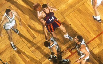 BOSTON, MA - DECEMBER 12: Richie Regan #14 of the Rochester Royals takes the jump shot over Bob Cousy #14 of the Boston Celtics during an NBA game on December 12, 1956 at the Boston Garden in Boston, Massachusetts.  (Photo by Hy Peskin/Getty Images) (Set Number: X4288)