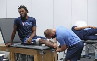 ORLANDO, FL - JULY 16: Justise Winslow #7 of the Memphis Grizzlies smiles and gets taped up during practice as part of the NBA Restart 2020 on July 16, 2020 in Orlando, Florida. NOTE TO USER: User expressly acknowledges and agrees that, by downloading and/or using this photograph, user is consenting to the terms and conditions of the Getty Images License Agreement.  Mandatory Copyright Notice: Copyright 2020 NBAE (Photo by Joe Murphy/NBAE via Getty Images)